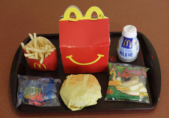 FILE - This Nov. 8, 2010 file photo shows a Happy Meal at a McDonald's restaurant in San Francisco, Ca. McDonald's, Burger King, Kentucky Fried Chicken and other fast-food companies are being sued in Chile for violating the country's new law against including toys with children's meals. The law took effect in July 2012 and its author, Sen. Guido Gerardi, filed suit Wednesday, Aug. 1, 2012, accusing the companies of knowingly endangering the health of children by marketing kids' meals with toys. (AP Photo/Eric Risberg, File)