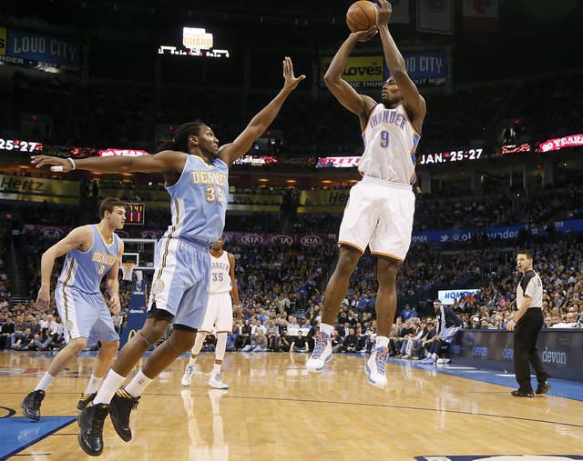 Oklahoma City's Serge Ibaka (9) shoots over Denver's Kenneth Faried (35) during the NBA basketball game between the Oklahoma City Thunder and the Denver Nuggets at the Chesapeake Energy Arena on Wednesday, Jan. 16, 2013, in Oklahoma City, Okla.  Photo by Chris Landsberger, The Oklahoman