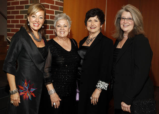 From left, DeDe Murcer Moffett, Barbara Murcer-Green, Carol Lane, and Lori Bedford pose for a photo during the OSU chapter of the American Association of University Women's fundraiser, An Evening of Arts and Fashion, on the campus of Oklahoma State University in Stillwater, Okla., Friday, March 16, 2012. Photo by Bryan Terry, The Oklahoman