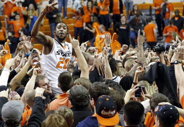 Oklahoma State's Michael Cobbins (20) celebrates with fans during the Bedlam men's college basketball game between the Oklahoma State University Cowboys and the University of Oklahoma Sooners at Gallagher-Iba Arena in Stillwater, Okla., Saturday, Feb. 16, 2013. Photo by Sarah Phipps, The Oklahoman