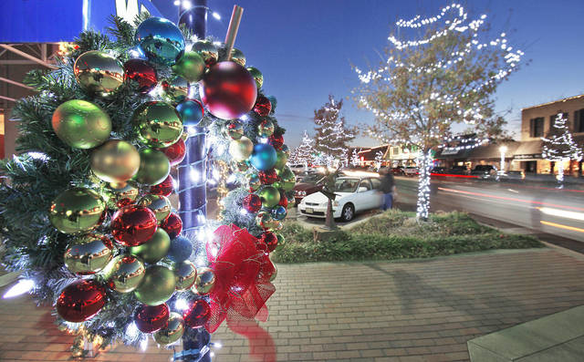 Above and right: Colorful ornaments and bright lights decorate wreaths throughout Edmond for the Christmas season. PHOTOS BY DAVID MCDANIEL, THE OKLAHOMAN