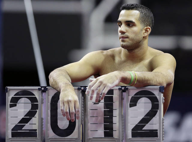 Danell Leyva takes a break during practice for the U.S. Olympic gymnastics trials, Wednesday, June 27, 2012, in San Jose, Calif. (AP Photo/Gregory Bull)