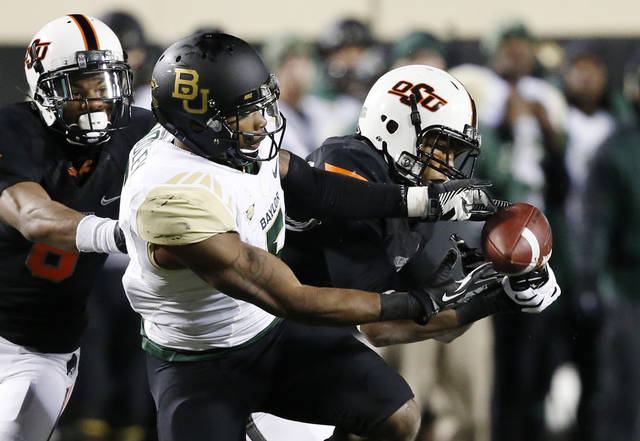 Oklahoma State has the edge on OU in offensive and defense efficiency. (AP Photo/Sue Ogrocki)