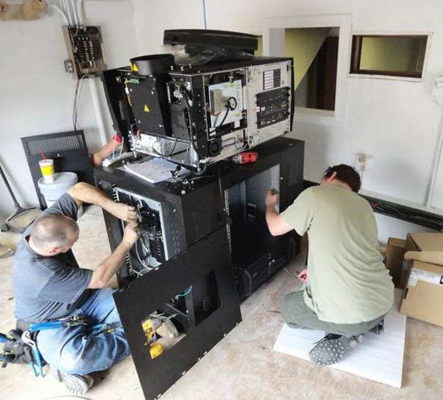Workers upgrade the projection equipment at the Royal Twin Theater in Pauls Valley. (Pauls Valley Democrat photo)
