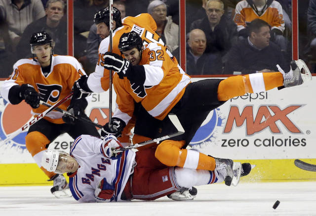 Philadelphia Flyers' Tom Sestito (32) collides with New York Rangers' Jeff Halpern (15) during the first period of an NHL hockey game, Thursday, Jan. 24, 2013, in Philadelphia. (AP Photo/Matt Slocum)