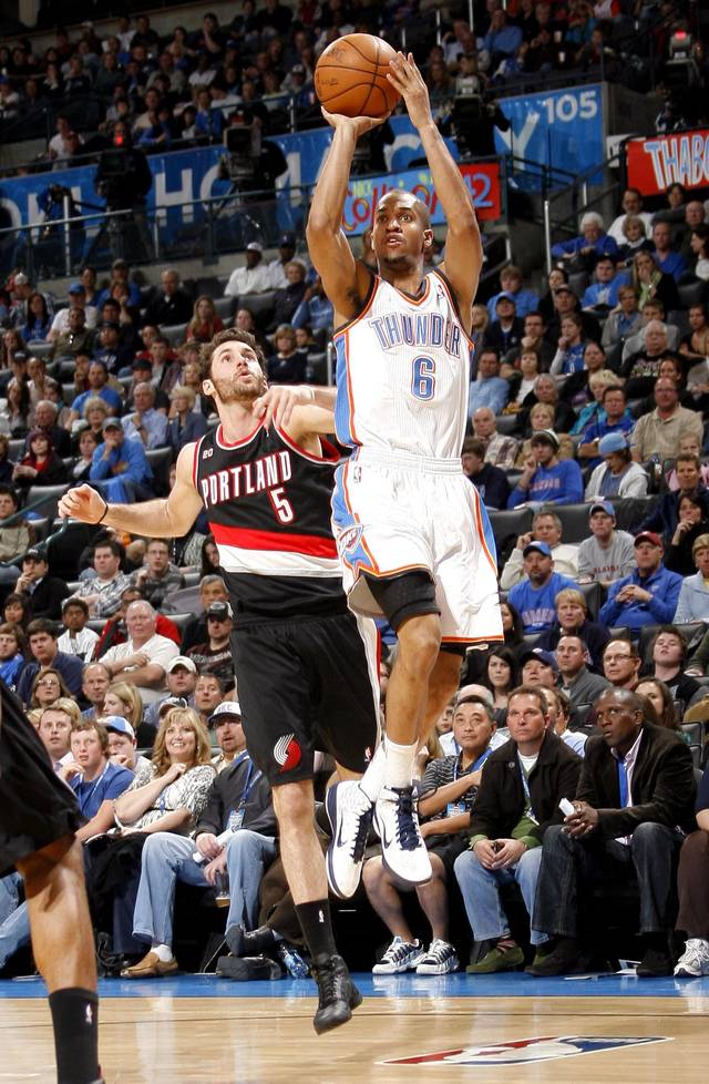 Oklahoma City's Eric Maynor (6) shoots in front of Portland's Rudy Fernandez (5) during the NBA game between the Oklahoma City Thunder and the Portland Trailblazers, Sunday, March 27, 2011, at the Oklahoma City Arena. Photo by Sarah Phipps, The Oklahoman