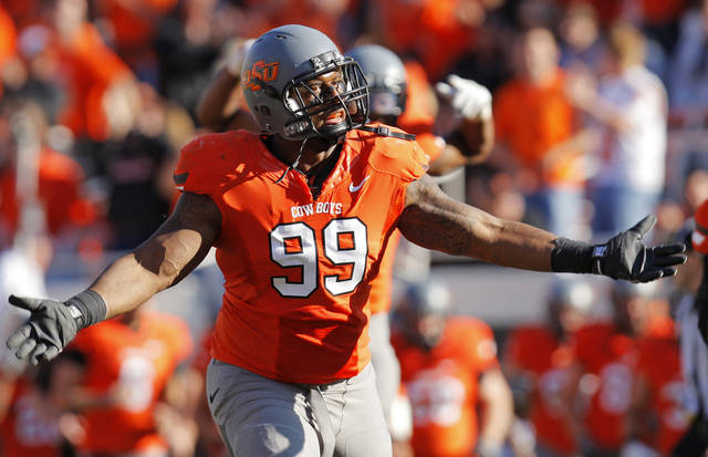 OSU's Richetti Jones (99) encourages the crowd at the end of the first half during a college football game between the Oklahoma State University Cowboys (OSU) and the Baylor University Bears (BU) at Boone Pickens Stadium in Stillwater, Okla., Saturday, Oct. 29, 2011. Photo by Nate Billings, The Oklahoman