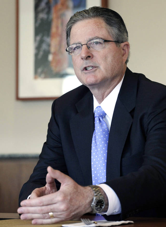 In this Thursday, Nov. 29, 2012 photo, Chevron CEO John Watson talks during an interview, in New York. Watson, 55, a California native and Chevron lifer, joined the company in 1980 as a financial analyst. Before becoming CEO in 2010 he was vice chairman in charge of strategic planning, business development and mergers and acquisitions. Watson also ran the company�s international exploration and production business, led the company�s integration with Texaco and was CFO.  (AP Photo/Mark Lennihan)