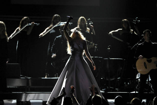 Carrie Underwood performs on stage at the 55th annual Grammy Awards on Sunday, Feb. 10, 2013, in Los Angeles. (Photo by John Shearer/Invision/AP) ORG XMIT: CAAR217