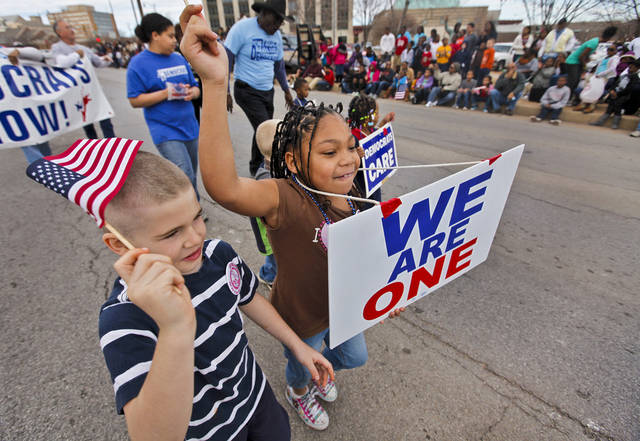 Micheal Mills, 7, and Ayanna Morales, 7, march in the streets during Martin Luther King Jr. Day parade through downtown Oklahoma City on Monday, Jan. 16, 2012, in Oklahoma City, Okla. Photo by Chris Landsberger, The Oklahoman