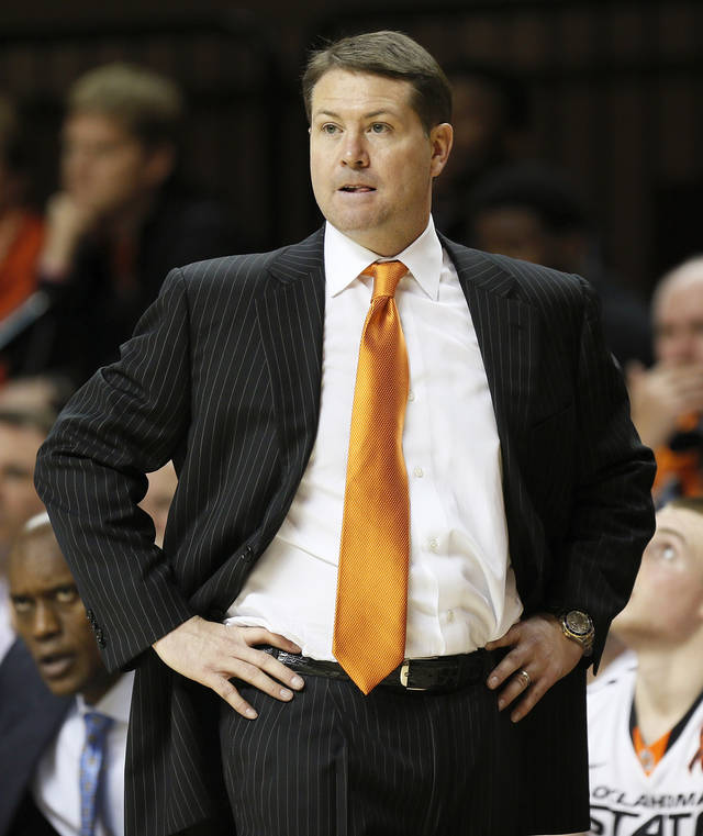 OSU head coach Travis Ford watches from the bench area during a men&#039;s college basketball game between Oklahoma State University and the University of Texas at Gallagher-Iba Arena in Stillwater, Okla., Saturday, March 2, 2013. OSU won, 78-65. Photo by Nate Billings, The Oklahoman
