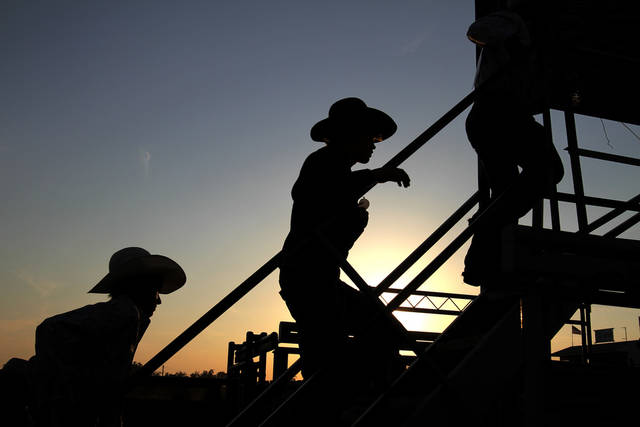 Participants line up to compete during the International Final Youths Rodeo in Shawnee, Okla., Sunday, July 10, 2011. Photo by Garet Fisbeck, The Oklahoman