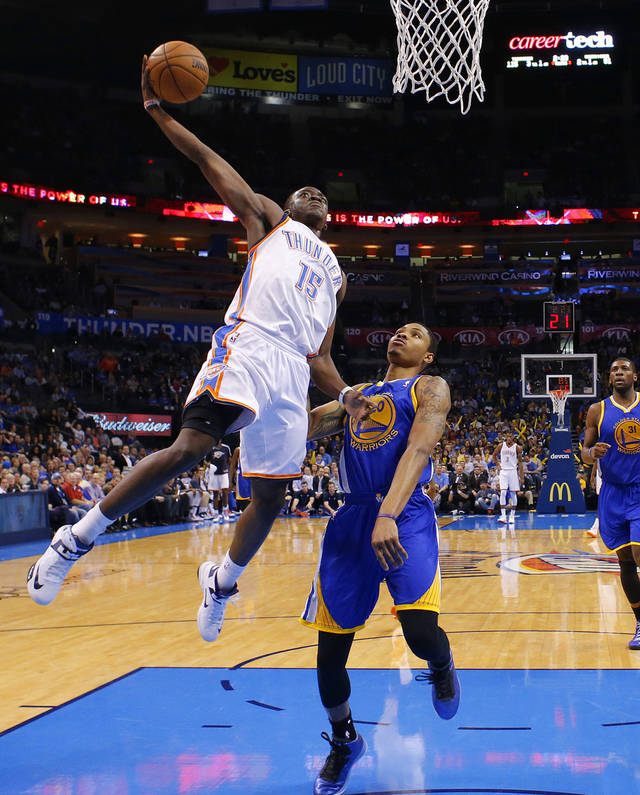 Oklahoma City&#039;s Reggie Jackson (15) goes to the basket beside Golden State&#039;s Kent Bazemore (20) during an NBA basketball game between the Oklahoma City Thunder and the Golden State Warriors at Chesapeake Energy Arena in Oklahoma City, Wednesday, Feb. 6, 2013. Photo by Bryan Terry, The Oklahoman
