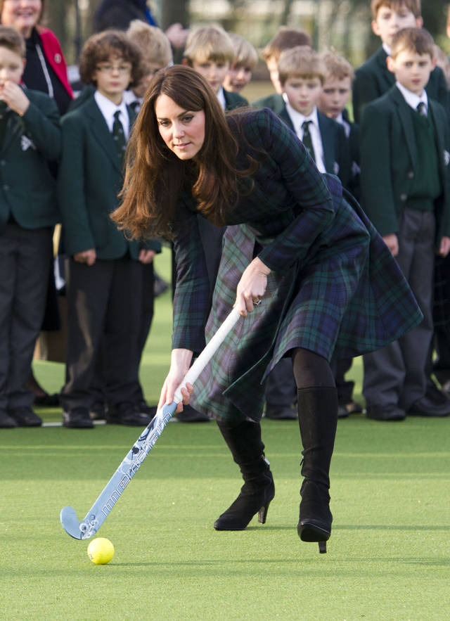 FILE - In this Friday, Nov. 30, 2012 file photo Kate, the Duchess of Cambridge, plays hockey during her visit to St. Andrew's School, where she  attended school from 1986 till 1995, in Pangbourne, England. The Duke and Duchess of Cambridge are very pleased to announce that the Duchess of Cambridge is expecting a baby, St James's Palace officially announced Monday Dec. 3, 2012. (AP Photo/Arthur Edwards, File)