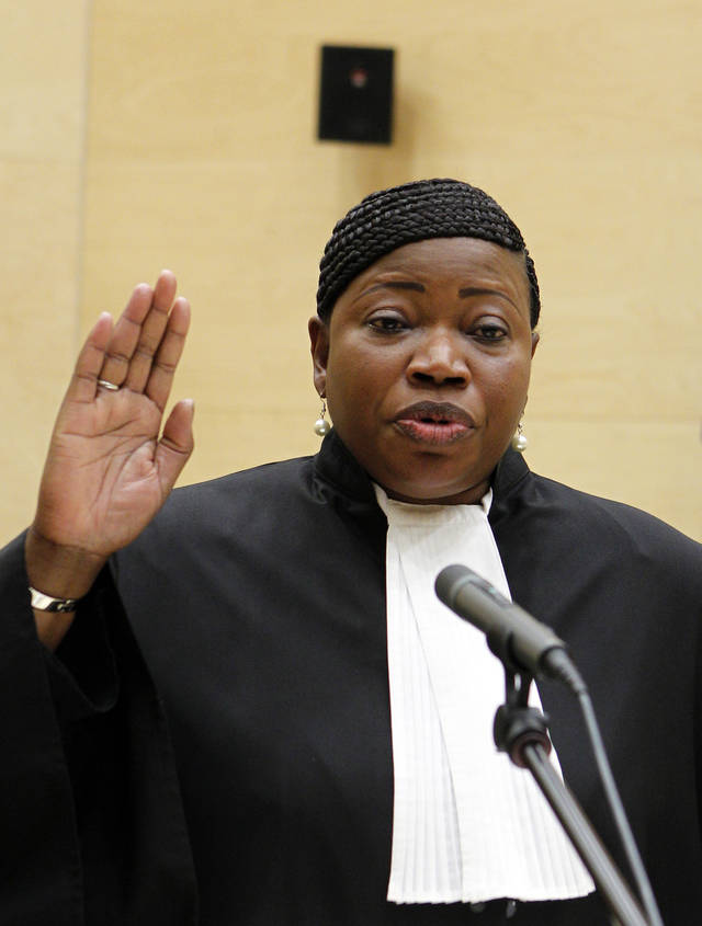 Gambian war crimes lawyer Fatou Bensouda, takes the oath during a swearing-in ceremony as its new prosecutor at The International Criminal Court (ICC) in The Hague, Netherlands, Friday, June 15, 2012. Bensounda replaces Luis Moreno-Ocampo. She will be tasked with trying to bring to justice alleged war criminals including Uganda's Joseph Kony, Libya's Seif al-Islam Gadhafi and Sudanese president Omar al-Bashir. (AP Photo/Bas Czerwinski, Pool)