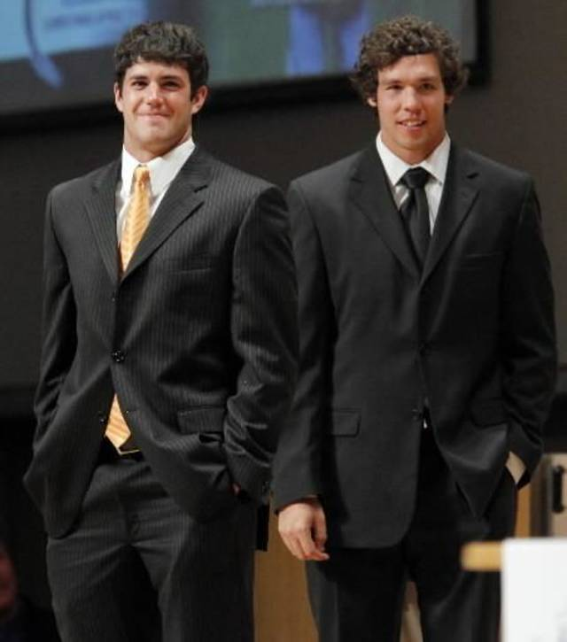 OSU quarterback Zac Robinson, left, and OU quarterback  Sam  Bradford stand together during the Fellowship of Christian Athletes All-State Banquet at the National Cowboy &amp; Western Heritage Museum in Oklahoma City, Monday, April 27, 2009. Robinson and  Bradford were special guests at the event. Photo by Nate Billings, The Oklahoman