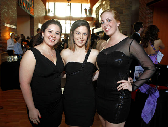 From left, Alexys Gonzales, Lindsey Goedecke, and Jori Solt pose for a photo during the OSU chapter of the American Association of University Women's fundraiser, An Evening of Arts and Fashion, on the campus of Oklahoma State University in Stillwater, Okla., Friday, March 16, 2012. Photo by Bryan Terry, The Oklahoman