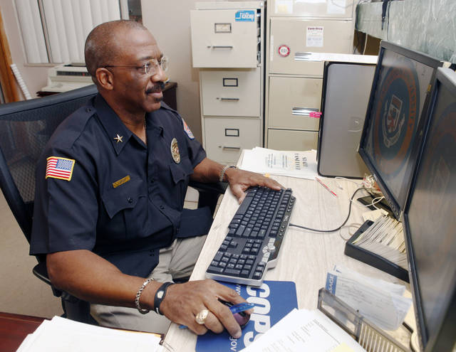 Frank Atkinson, Langston University�s chief of police since August, says he is working to build a rapport with students.  Photo by Paul Hellstern, The Oklahoman