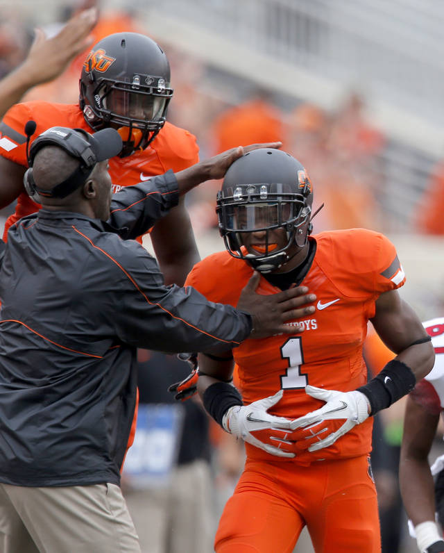 Oklahoma State's Kevin Peterson (1) celebrates a broken pass play during a college football game between Oklahoma State University (OSU) and the University of Louisiana-Lafayette (ULL) at Boone Pickens Stadium in Stillwater, Okla., Saturday, Sept. 15, 2012. Photo by Sarah Phipps, The Oklahoman