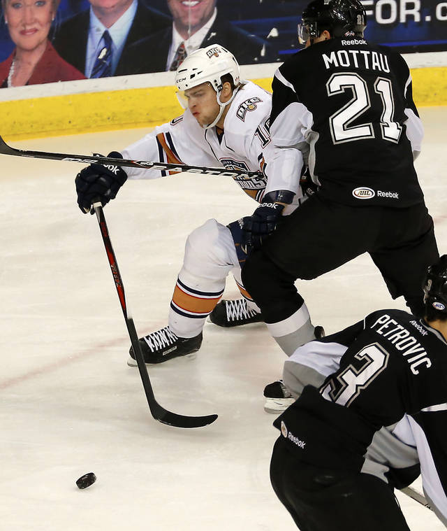 Teemu Hartikainen of the Oklahoma City Barons tries to get past Mike Mottau of the San Antonio Rampage during an AHL hockey game at the Cox Convention Center in Oklahoma City, Friday, Dec. 28, 2012. Photo by Bryan Terry, The Oklahoman