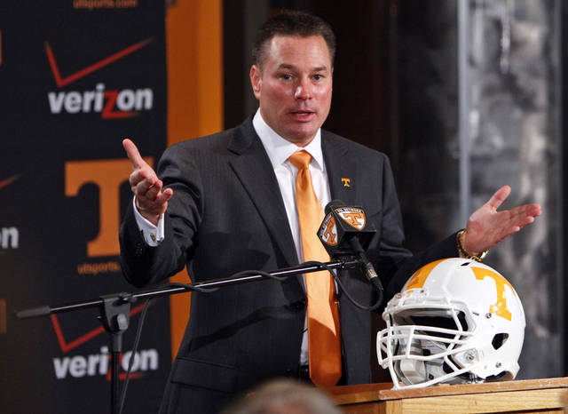 FILE - In this Dec. 7, 2012 file photo, Butch Jones, Tennessee's new head football coach, speaks during an NCAA college football new conference in Knoxville, Tenn. Jones faces a tough balancing act. The coach wants to encourage fans with his hopes to make Tennessee a football contender again, but he also must remind them that the transformation may take time. (AP Photo/Wade Payne, File)