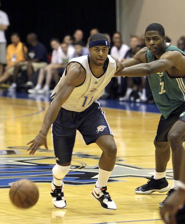 Oklahoma City Thunder's Mustafa Shakur, left, tires to get around Boston Celtics' DeShawn Sims during the first half of an NBA summer league basketball game in Orlando, Fla., Monday, July 5, 2010.(AP Photo/John Raoux) ORG XMIT: FLJR107