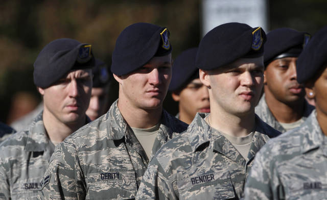 Troops from Tinker AFB march in the Veteran's Day parade. The city of Midwest City teamed with civic leaders and local merchants to display their appreciation for veterans and active military forces by staging a hour-long Veteran's Day parade that stretched more than a mile and a half along three of the city's busiest streets Monday morning, Nov. 12, 2012. Hundreds of people lined the parade route, many of them waving small American flags that had ben distributed by volunteers who marched near the front of the parade. A fly-over performed by F-16s from the138th Fighter Wing, Oklahoma Air National Guard unit in Tulsa thrilled spectators. Five veterans representing military personnel who served in five wars and military actions served as  Grand Marshals for the parade. Leading the parade was the Naval Reserve seven-story American flag, carried by 100 volunteers from First National Bank of Midwest City, Advantage Bank and the Tinker Federal Credit Union. The flag is 50 feet by 76 feet, weighs 110 pounds and was sponsored by the MWC Chapter of Disabled American Veterans. Photo by Jim Beckel, The Oklahoman