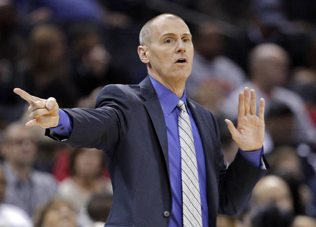 Dallas Mavericks coach Rick Carlisle talks to his players during the first half of an NBA basketball game against the Charlotte Bobcats in Charlotte, N.C., Saturday, Nov. 10, 2012. (AP Photo/Chuck Burton)