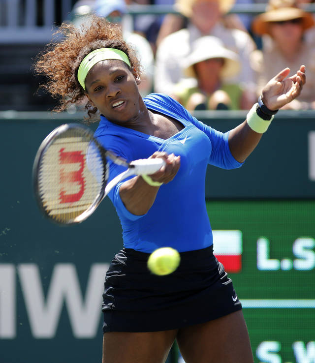 Serena Williams hits a shot to Lucie Safarova, of the Czech Republic, during the final at the Family Circle Cup tennis tournament in Charleston, S.C., Sunday, April 8, 2012. Williams won 6-0, 6-1. (AP Photo/Mic Smith) ORG XMIT: SCMS108