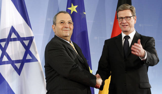 The Foreign Minister of Germany Guido Westerwelle, right, and the Defense Minister of Irsael Ehud Barak, left, shake hands prior to a meeting at the Foreign Office in Berlin, Germany, Wednesday, March 21, 2012. (AP Photo/Michael Sohn)