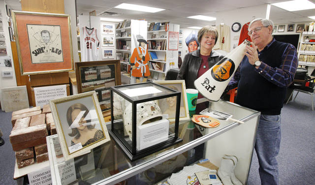 Gloria Quaid, Putnam City class of 63, and Mike Brake, class of 65, with items on display at the Putnam City Schools Museum in Warr Acres Monday, Feb. 6, 2012. Photo by Paul B. Southerland, The Oklahoman