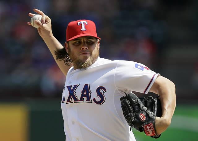 Texas Rangers relief pitcher Cory Burns delivers to the Houston Astros in the fifth inning of a baseball game on Sunday, July 7, 2013, in Arlington, Texas. Burns earned his first major league win in the 5-4 Rangers win.  (AP Photo/Tony Gutierrez)