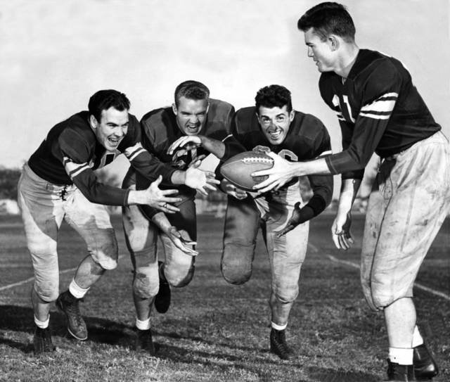 "Taking off for the 1946 Sooner backfield here are, from the left, Halfback Joe Golding, Fullback Eddy Davis, Halfback Jack Mitchell and Quarterback Darrell Royal."" OKLAHOMAN ARCHIVE PHOTO"