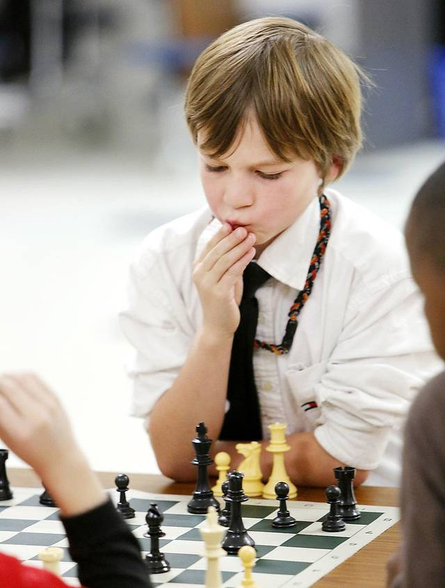 Ashton Pavao, a third grader, studies a chess move during a chess club meeting at Freeman Elementary School in Edmond. Photo By Steve Gooch, The Oklahoman &lt;strong&gt;Steve Gooch - The Oklahoman&lt;/strong&gt;