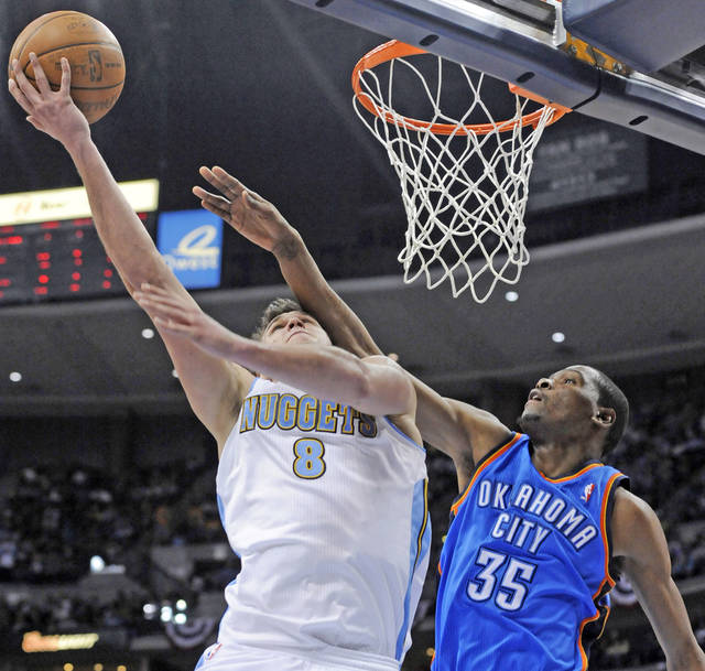 Denver forward Danilo Gallinari, left, puts up a shot against Thunder forward Kevin Durant during the Nuggets' win Monday. AP PHOTO