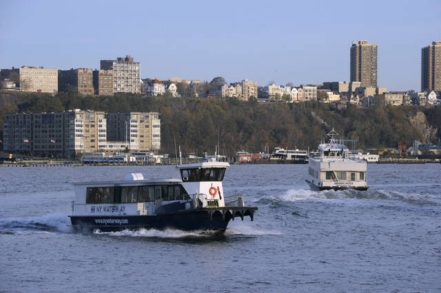 <p>New York Waterway ferries carry commuters across the Hudson River to the Midtown Manhattan ferry terminal, Thursday morning, Nov. 1, 2012 in New York. Ferry service is running on a limited schedule in the wake of superstorm Sandy. (AP Photo/Joe Epstein)</p>