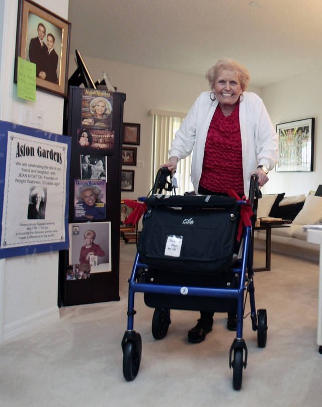 In this photo taken Monday, July, 18, 2011, Jean Nidetch, founder of Weight Watchers, is shown at her home in Parkland, Fla. Fifty years after Nidetch went on the diet that changed her life, she says she still lives by most of the ideals she espoused when she started the international weight loss group 50 years ago at her New York City home. (AP Photo/Alan Diaz)