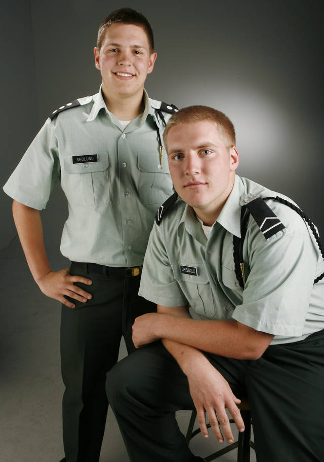 Nathan Sholund, left, and Jared Griswold, class of 2008 Mustang High School graduates, pose for a photo in the OPUBCO studio Wednesday, April 30, 2008. BY NATE BILLINGS, THE OKLAHOMAN