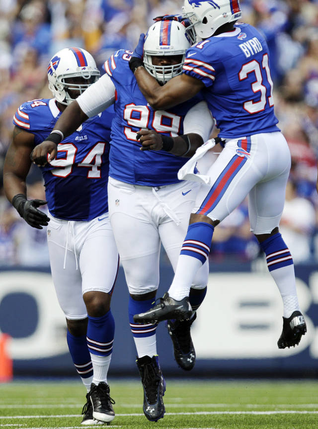 Buffalo Bills' Marcell Dareus (99) celebrates his sack with Jarius Byrd (31) against the Kansas City Chiefs during the first half of an NFL football game in Orchard Park, N.Y., Sunday, Sept. 16, 2012. (AP Photo/Gary Wiepert)
