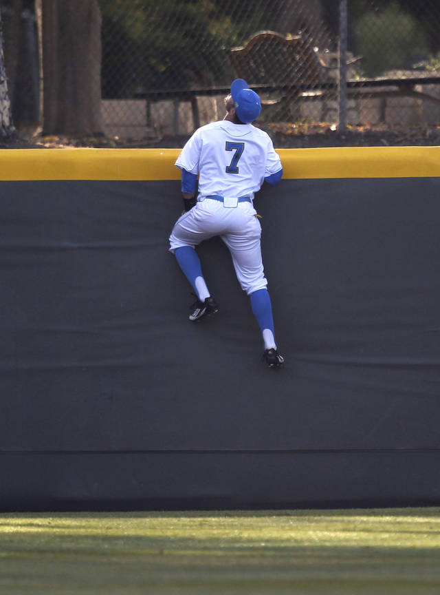 UCLA's Cody Keefer watches a home run by TCU's Josh Elander clear the fence in the first inning of an NCAA college baseball tournament super regional game in Los Angeles, Friday, June 8, 2012. (AP Photo/Jae C. Hong)