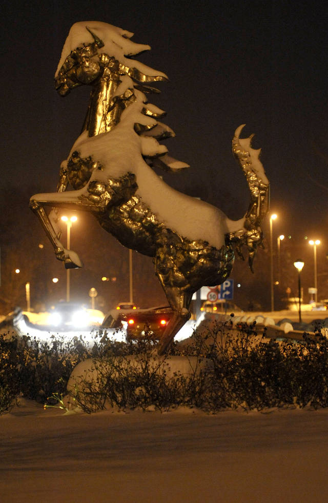 The Ferrari Rampant Horse Is Covered With Snow Outside The