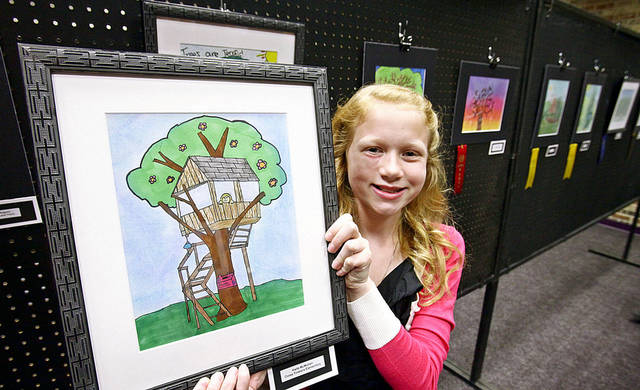Cross Timbers Elementary School fifth-grader Halle McMullen poses with her first-place poster.