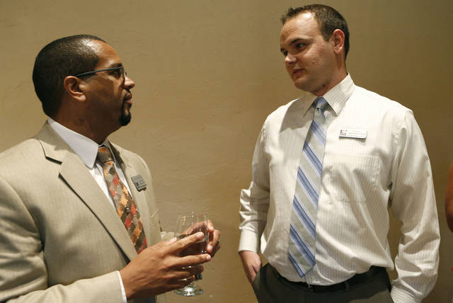 Jason Brown, left, talks with Cordell Ehrich, Cimarron Middle School principal, at a new teachers reception held by the Edmond Area Chamber of Commerce. PHOTO BY SARAH PHIPPS, THE OKLAHOMAN. <strong>SARAH PHIPPS - THE OKLAHOMAN</strong>