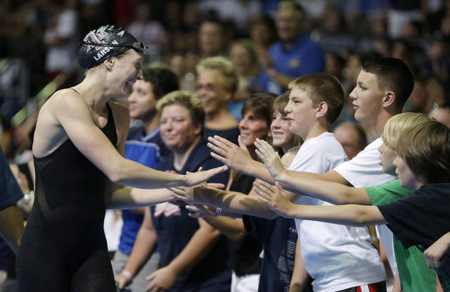 Breeja Larson celebrates with fans after her win in the women's 100-meter breaststroke final at the U.S. Olympic swimming trials, Wednesday, June 27, 2012, in Omaha, Neb. (AP Photo/Mark Humphrey)