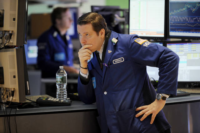 "Gregg Maloney of Barclays works on the floor of the New York Stock Exchange the day after Pres. Barack Obama was re-elected, Wednesday, Nov. 7, 2012 in New York.With President Barack Obama elected to another term, U.S. investors dumped stocks Wednesday and turned their focus to a world of problems, including a ""fiscal cliff"" of tax increases and spending cuts at home and a deepening recession in Europe. (AP Photo/Henny Ray Abrams)"