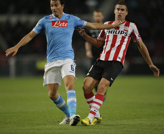 Napoli player Salvatore Aronica pushes PSV player Kevin Strootman during the Europa League Group F soccer match at Philips stadium in Eindhoven, Netherlands, Thursday Oct. 4, 2012. PSV won with a 3-0 score. (AP Photo/Peter Dejong)