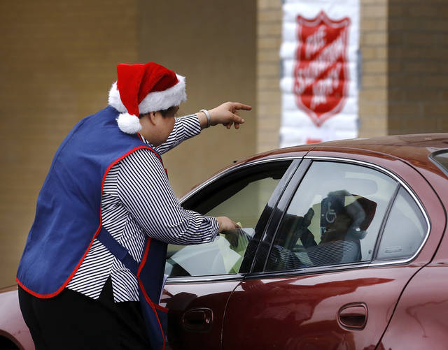 A Salvation Army volunteer directs a client who arrives at Crossroads Mall to pick up toys. The Salvation Army and Feed the Children teamed to distribute bicycles and toys for children,  and handed out boxes of food for families at their annual distribution event Wednesday, Dec. 19, 2012. Salvation Army officials said 100 volunteers helped make the event go smoothly. The volunteers loaded bags of toys and bikes into vehicles of clients who had been pre-approved for assistance.  Many of the gifts were provided through the Salvation Army's Angel Tree program   Photo by Jim Beckel, The Oklahoman
