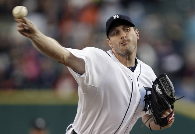 Detroit Tigers pitcher Max Scherzer throws to an Oakland Athletics batter in the first inning of a baseball game in Detroit on Tuesday, Sept. 18, 2012. (AP Photo/Paul Sancya)