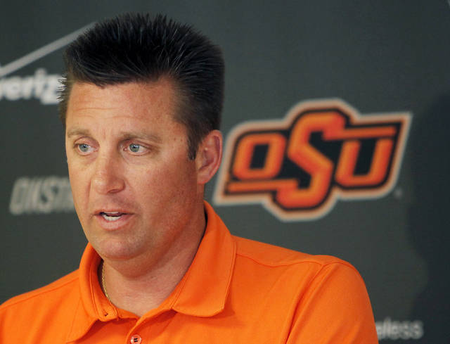 COLLEGE FOOTBALL: Head coach Mike Gundy speaks to the media during the OSU spring football press conference at Boone Pickens Stadium on the campus of Oklahoma State University in Stillwater, Okla., Monday, March 12, 2012. Photo by Nate Billings, The Oklahoman