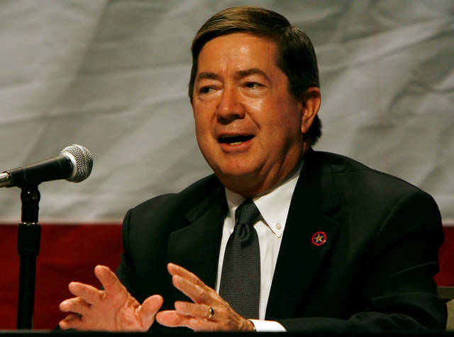 Gubernatorial candidate Drew Edmondson answers a question during a forum for candidates to speak on education issues at the Department of Education's leadership conference in Tulsa, Okla., on July 23,2010. JAMES GIBBARD/Tulsa World